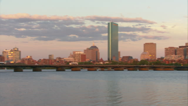 ws view of downtown boston across charles river with harvard bridge, prudential tower and hancock tower in distance / boston, massachusetts, usa - harvard bridge stock videos & royalty-free footage