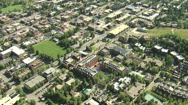 WS ZI AERIAL View of downtown buildings, rugby field and hotels with outdoor swimming pool / Aspen, Colorado, United States