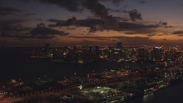 ws aerial view of downtown buildings with green lights and roofs of building at night / miami, florida, united states - atmosphere filter stock videos & royalty-free footage