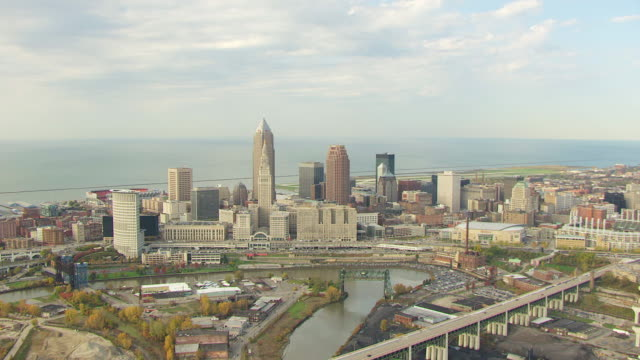 ws aerial view of downtown buildings with lake erie / cleveland, ohio, united states - cleveland ohio stock videos and b-roll footage