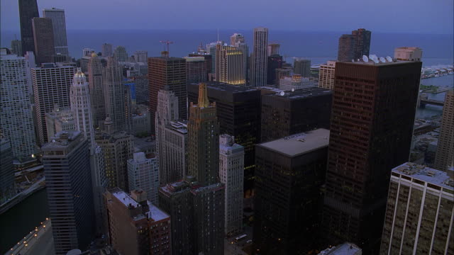aerial view of downtown chicago with lake michigan in background at sunset / illinois, usa - great lakes stock videos & royalty-free footage