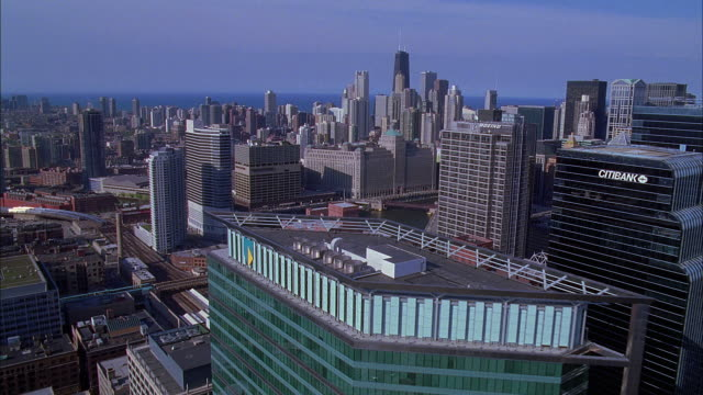 aerial view of downtown chicago with lake michigan in background / illinois, usa - great lakes stock videos & royalty-free footage