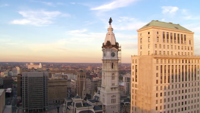 ws pan view of downtown city center buildings to pnb building / philadelphia, pennsylvania, united states - rathaus von philadelphia stock-videos und b-roll-filmmaterial