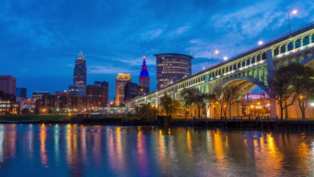 view of downtown cleveland skyline in ohio usa at twilight - cleveland ohio stock videos and b-roll footage