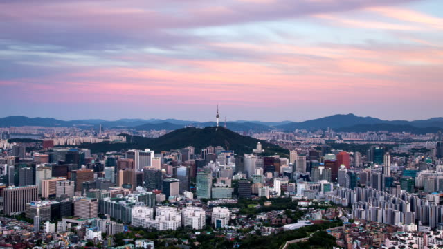 view of downtown district and n seoul tower (famous tourist attractions) area at day and night time in seoul - time of day stock videos and b-roll footage