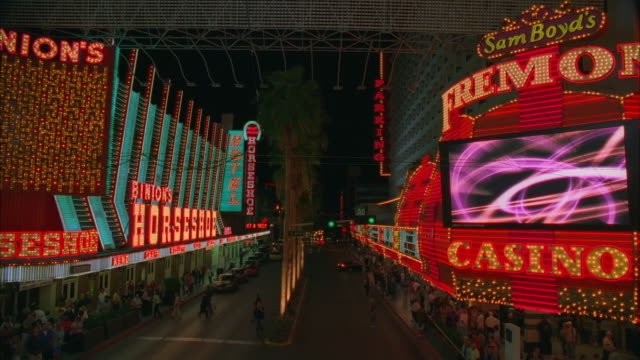ws td view of downtown 'fremont street', 'horseshoe casino' and 'fremont casino' / las vegas, nevada, usa - horseshoe stock videos and b-roll footage