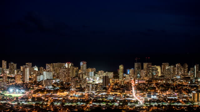 view of downtown honolulu at night - oahu bildbanksvideor och videomaterial från bakom kulisserna