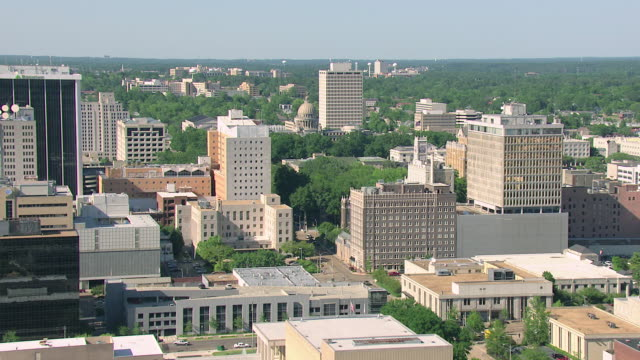 WS AERIAL View of downtown / Jackson, Mississippi, United States buildings and approach Capitol building