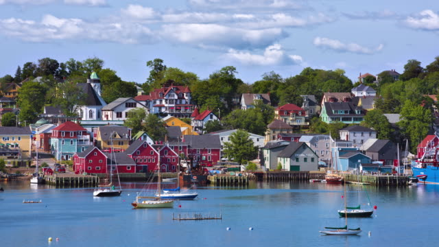 t/l view of downtown lunenburg and its harborfront on a sunny day / lunenburg, nova scotia, canada - nova scotia stock videos and b-roll footage