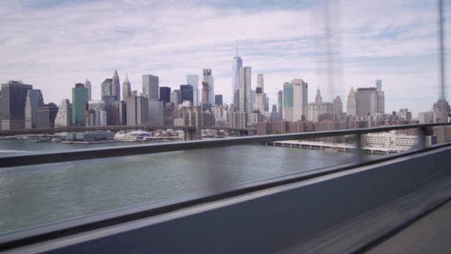 view of downtown manhattan, fdr drive, brooklyn bridge, and the east river while crossing over manhattan bridge. - river east stock videos & royalty-free footage