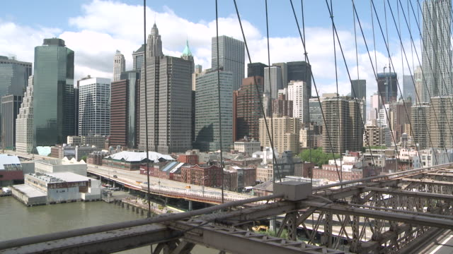 ws view of downtown manhattan through brooklyn bridge / new york, new york, united states - brooklyn bridge stock videos & royalty-free footage