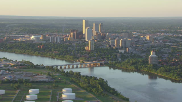 ws aerial view of downtown on arkansas river / tulsa, oklahoma, united states - oklahoma stock-videos und b-roll-filmmaterial
