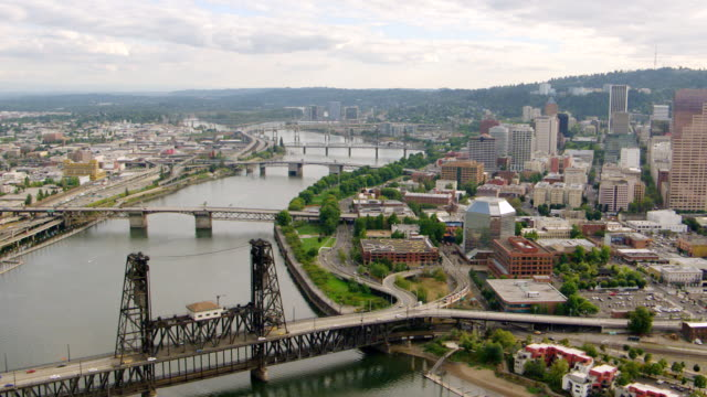 WS AERIAL View of downtown Portland bridges over Willamette River / Oregon, United States