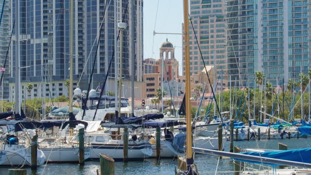 view of downtown saint petersburg, florida, from the pier, over the marina and many yachts and boats. - marina stock videos & royalty-free footage