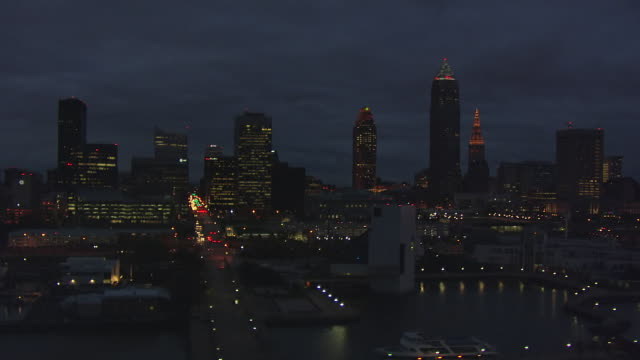 ws aerial view of downtown skyline in early evening / cleveland, ohio, united states - cleveland ohio stock videos and b-roll footage