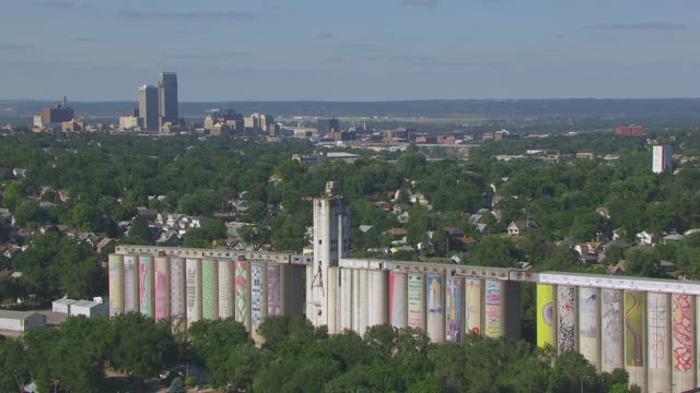 ws aerial view of downtown to painted grain elevators / omaha, nebraska, united states - nebraska stock videos & royalty-free footage