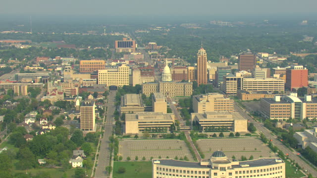 ws aerial view of downtown with buildings and capitol building / lansing, michigan, united states - lansing stock videos and b-roll footage