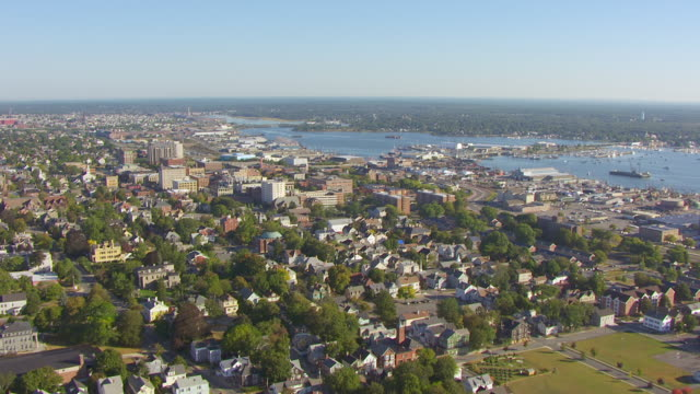 ws aerial pov view of downtown with dock/ new bedford, massachusetts, united states - new bedford stock videos & royalty-free footage
