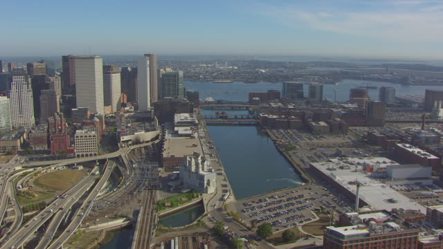 WS AERIAL POV View of downtown with elevated road in foreground / Fort Point Channel, Boston, Massachusetts, United States