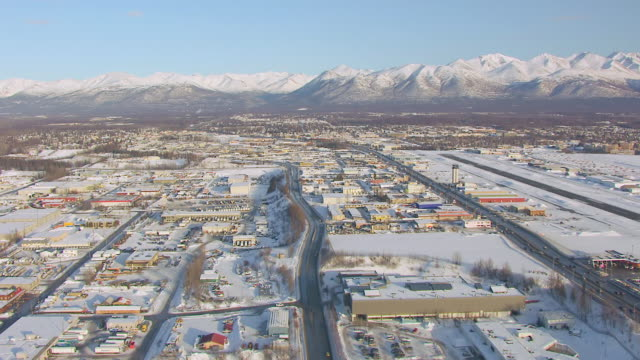 ws aerial view of downtown with mountains / anchorage, alaska, united states - anchorage alaska stock videos & royalty-free footage