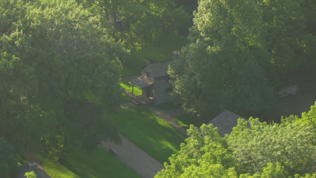 WS AERIAL POV View of Dr. Francis Regnier office log cabin at Lincoln's New Salem State Historic Site / Menard County, Illinois, United States