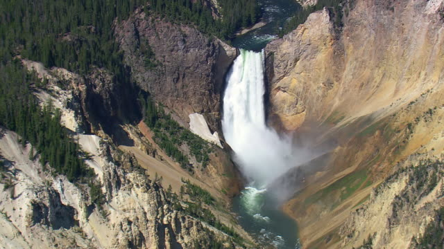 ws aerial view of dramatic scenery of yellowstone waterfall / wyoming, united states - イエローストーン国立公園点の映像素材/bロール