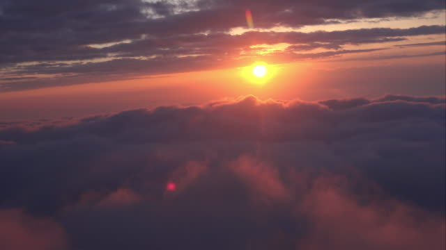WS AERIAL POV View of dramatic sky with cloudscape at sunrise