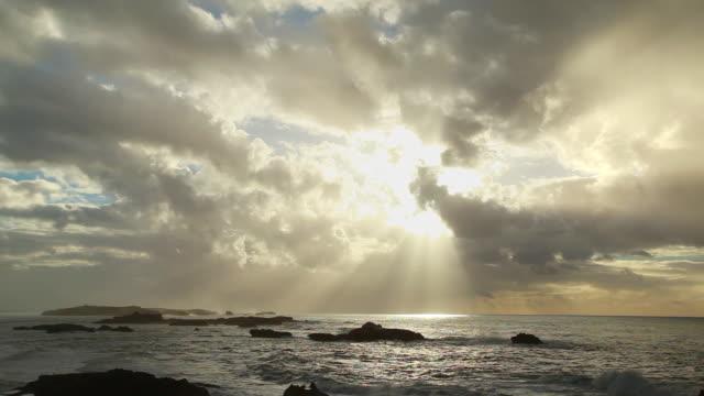 ws view of dramatic sun and clouds over atlantic ocean / essouira, morocco - ドラマチックな空模様点の映像素材/bロール