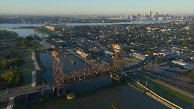 WS POV AERIAL View of drawbridge along canal it intersects the Mississippi River / New Orleans, Louisiana, USA