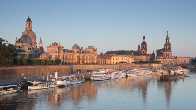 WS View of Dresden skyline and river boats on Elbe river at sunrise / Dresden, Saxony, Germany