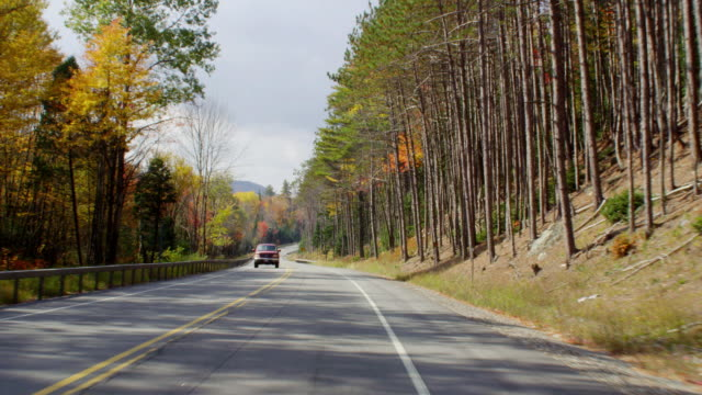 ws pov view of driving on two lane highway during autumn with beautiful foliage / upstate new york, united states - sedan stock videos & royalty-free footage