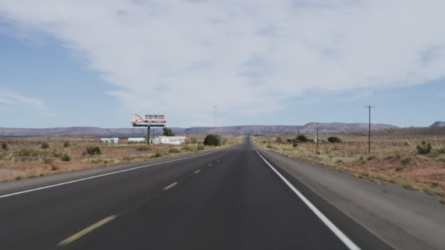 WS POV View of driving on two-lane highway in Southwestern USA / New Mexico, United States