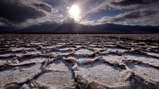 ws la pov view of dry  cracked earth and salt flats / death valley np, california, united states  - death valley national park stock videos & royalty-free footage