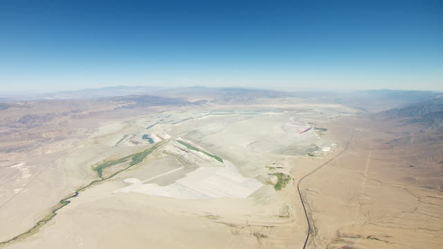 ws td aerial pov view of dry owens lake bed in owens valley with inyo mountains in background / california, united states - basin and range province stock videos and b-roll footage