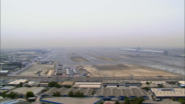 aerial view of dubai airport and highway, dubai, united arab emirates - 2008 stock videos and b-roll footage