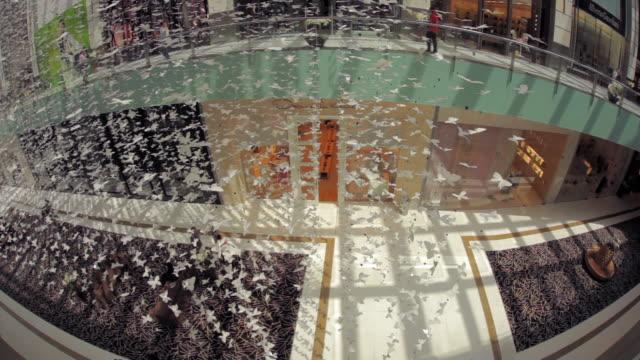 ws view of dubai mall / dubai, united arab emirates - abbondanza video stock e b–roll