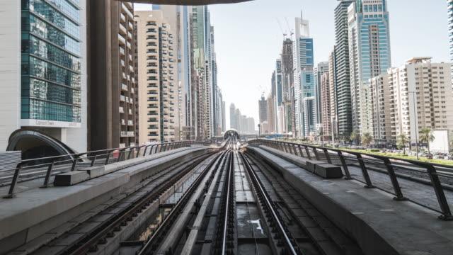t/l pov view of dubai metro / dubai, uae - rail transportation stock videos & royalty-free footage