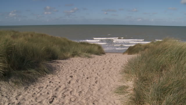 ws view of dunes in front of sea / ostend, flanders, belgium - coastline stock videos & royalty-free footage