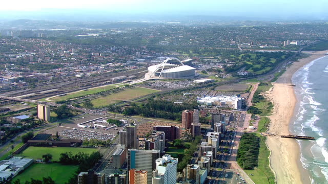 ws aerial view of durban and moses mabhida stadium / durban, kwazulu-natal, south africa - durban stock videos and b-roll footage
