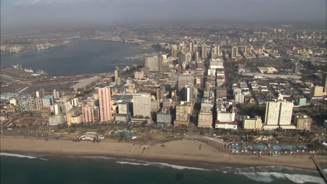 WS AERIAL View of Durban city centre and harbour / Durban, Kwazulu-Natal, South Africa