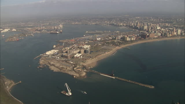ws pov aerial view of durban harbour entrance with city in background / durban, kwazulu-natal, south africa - durban stock videos and b-roll footage
