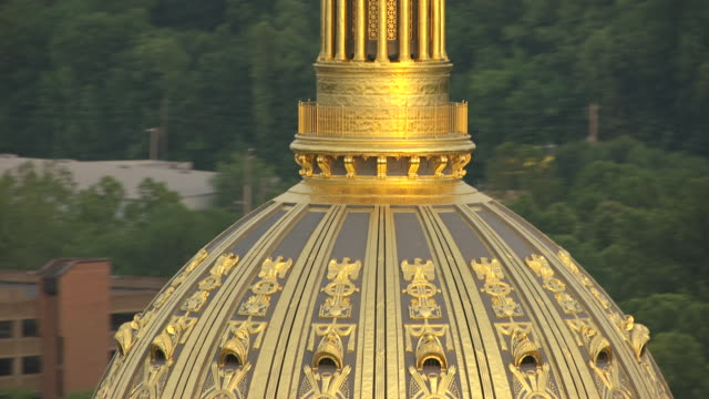 cu ts tu aerial view of eagle at top of dome to gold building detail / charleston, west virginia, united states - dome stock videos & royalty-free footage
