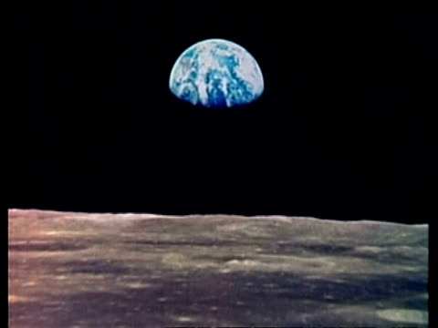 wa view of earth from apollo saturn 17 on lunar surface, zoom in to cu of earth partly in shadow - 宇宙探検点の映像素材/bロール