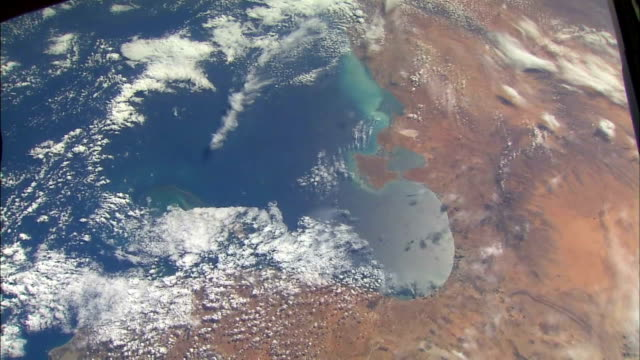 view of earth from space showing northern tunisia in africa / coastline with sea and clouds - territorio video stock e b–roll