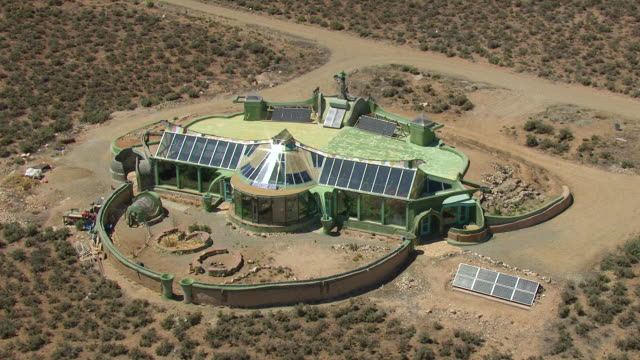 WS AERIAL DS View of Earthship solar house made of natural and recycled materials in Taos County / New Mexico, United States