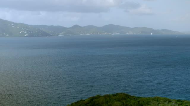 ws tu aerial pov view of east end bay with mountain range in background / east end, saint john, us virgin islands, united states - saftig bildbanksvideor och videomaterial från bakom kulisserna