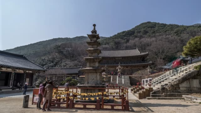 view of east five-story stone pagoda at daeungjeon hall and gakhwangjeon hall of hwaeomsa temple(national cultural heritages) in guryegun, jeollanam-do, south korea - jeollanam do stock videos & royalty-free footage