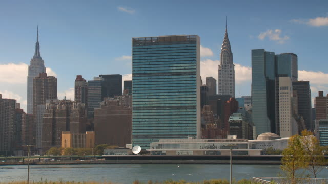 ws view of east side skyline / new york city, new york, usa - united nations building stock videos and b-roll footage