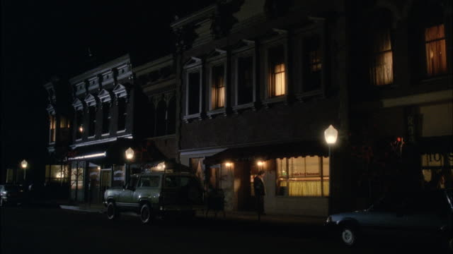 MS View of eastern town house with lights on