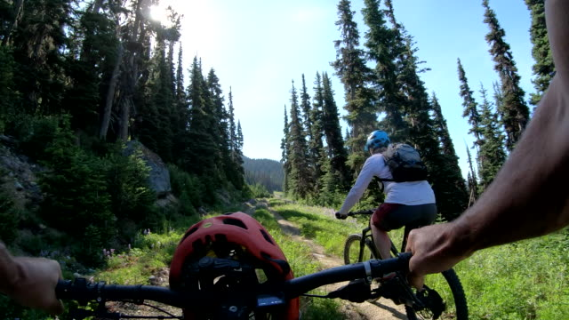 pov view of e-biker ascending mountain trail - bicycle trail outdoor sports stock videos & royalty-free footage